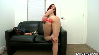 Ginger Maxx sticks a red dildo anally
