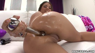 Jynx Maze pushes the silver toy deeper into her anal gates