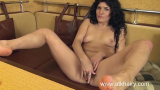 Markiza masturbates her furry pussy in a table booth