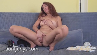 Mature Karolina Masturbates on a Gray Couch