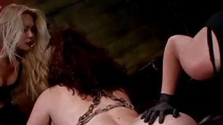 Tied up lesbian gets huge strapon