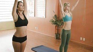 Two pretty women learned some relaxing yoga exercises