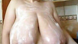 Milf puts foam on her huge tits on webcam