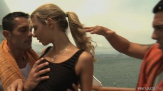Hot blonde Kristi Lust giving a double blowjob