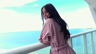 Naughty brunette babe flashing on a balcony